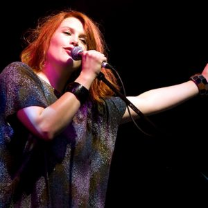 Clare Bowditch singing on stage
